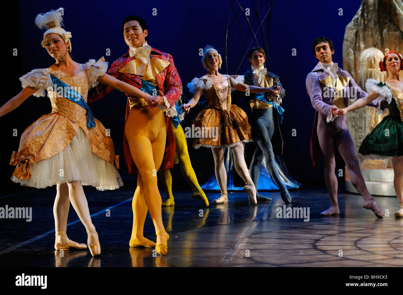 Stepsisters and Guests Ballroom dancing at Prince Charming palace in Ballet Jorgen production of Cinderella - Stock Image