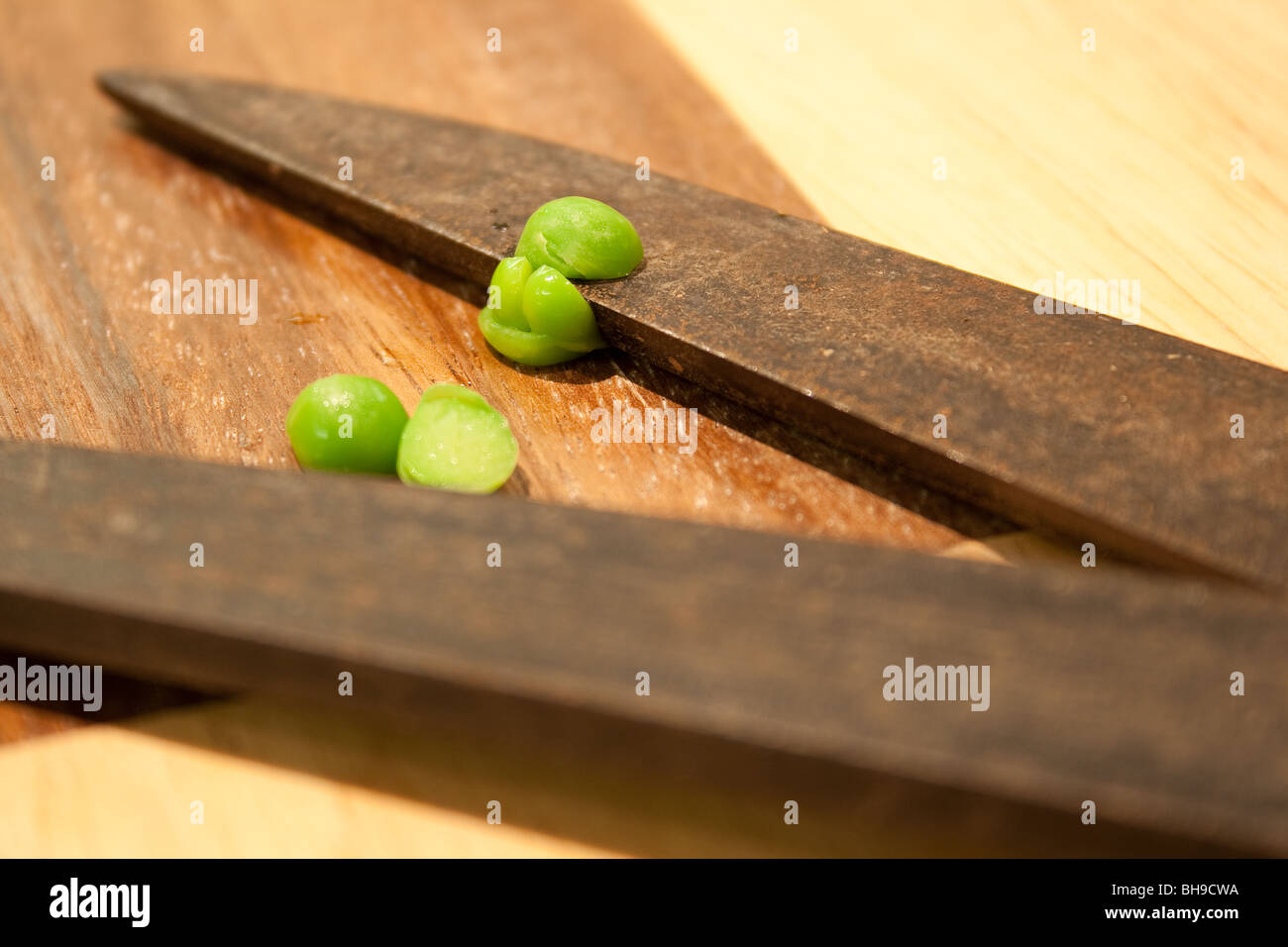 Two peas, sliced in two by garden shears, a comedy image Stock Photo ...