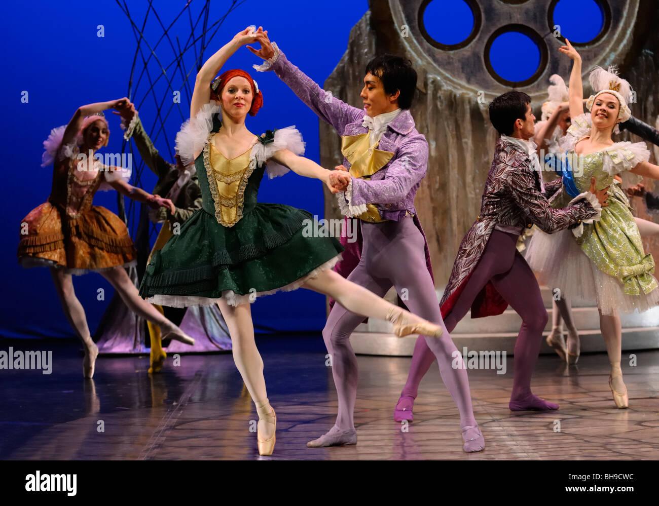 Stepsister ballerinas en pointe and Guests Ballroom dancing in Ballet Jorgen production of Cinderella - Stock Image