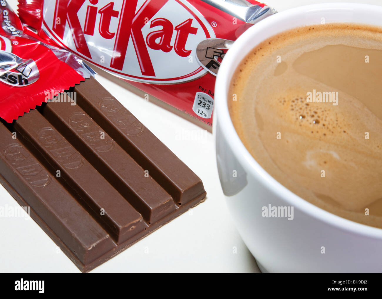 Nestle's Kitkat bar with a cup of coffee. - Stock Image