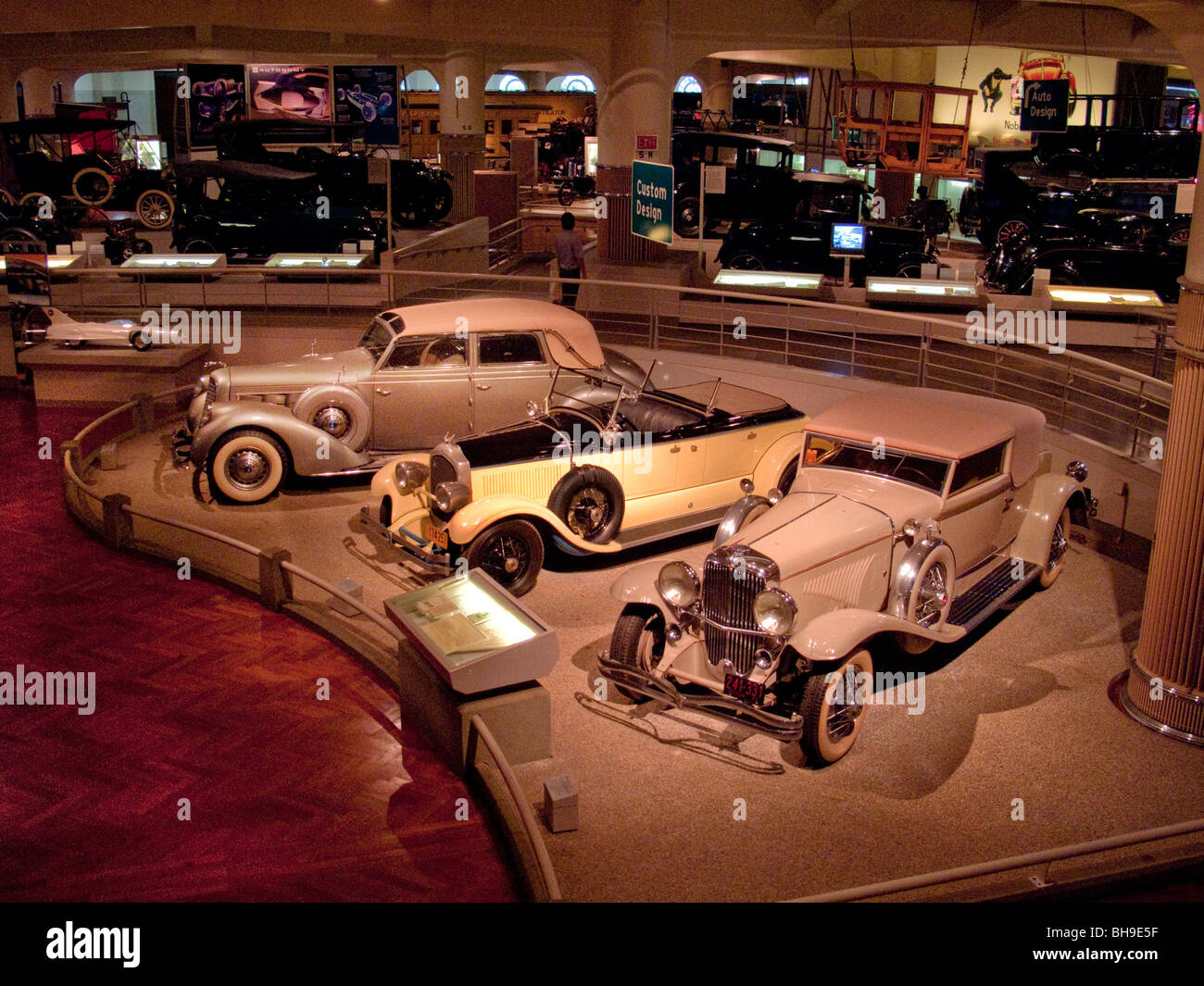 Three luxurous custom built autos are on display at the henry ford museum in dearborn michigan