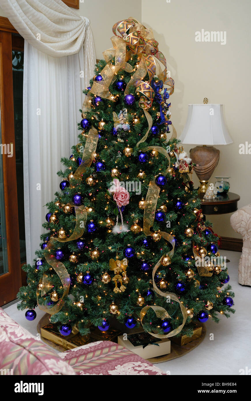 An elegant Christmas tree decorated with gold and blue