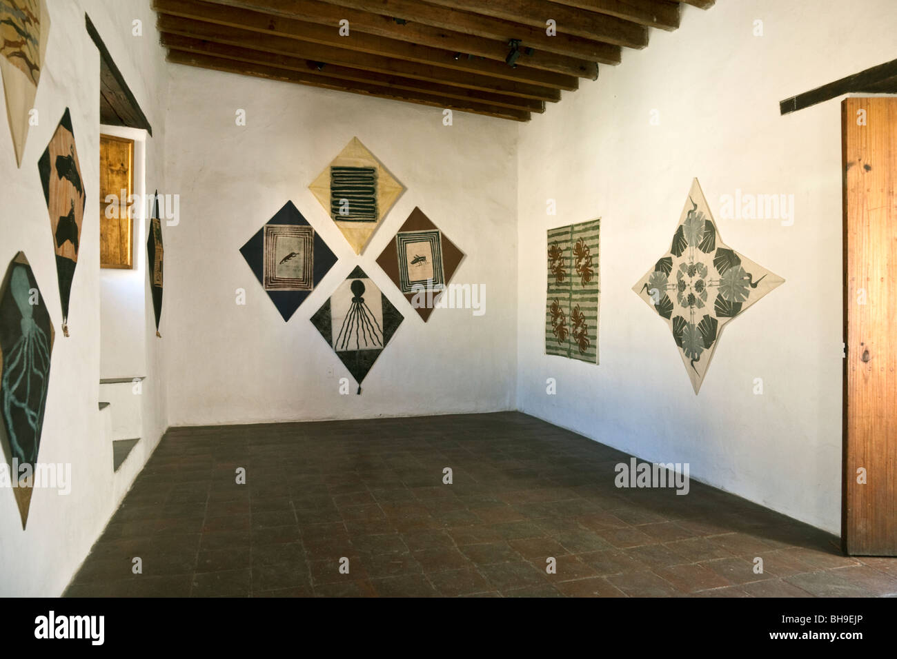 light filled gallery of Museum of Graphic Arts Oaxaca city with exhibit of kites using pigments & motifs from - Stock Image