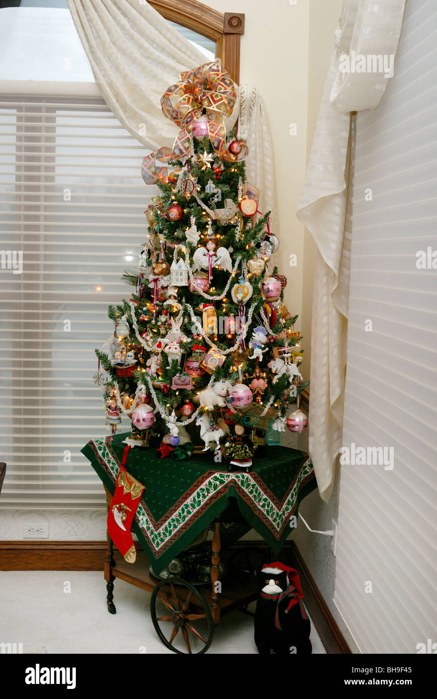 A Small Beautifully Decorated Christmas Tree Sits On A Tree In The Stock Photo Alamy