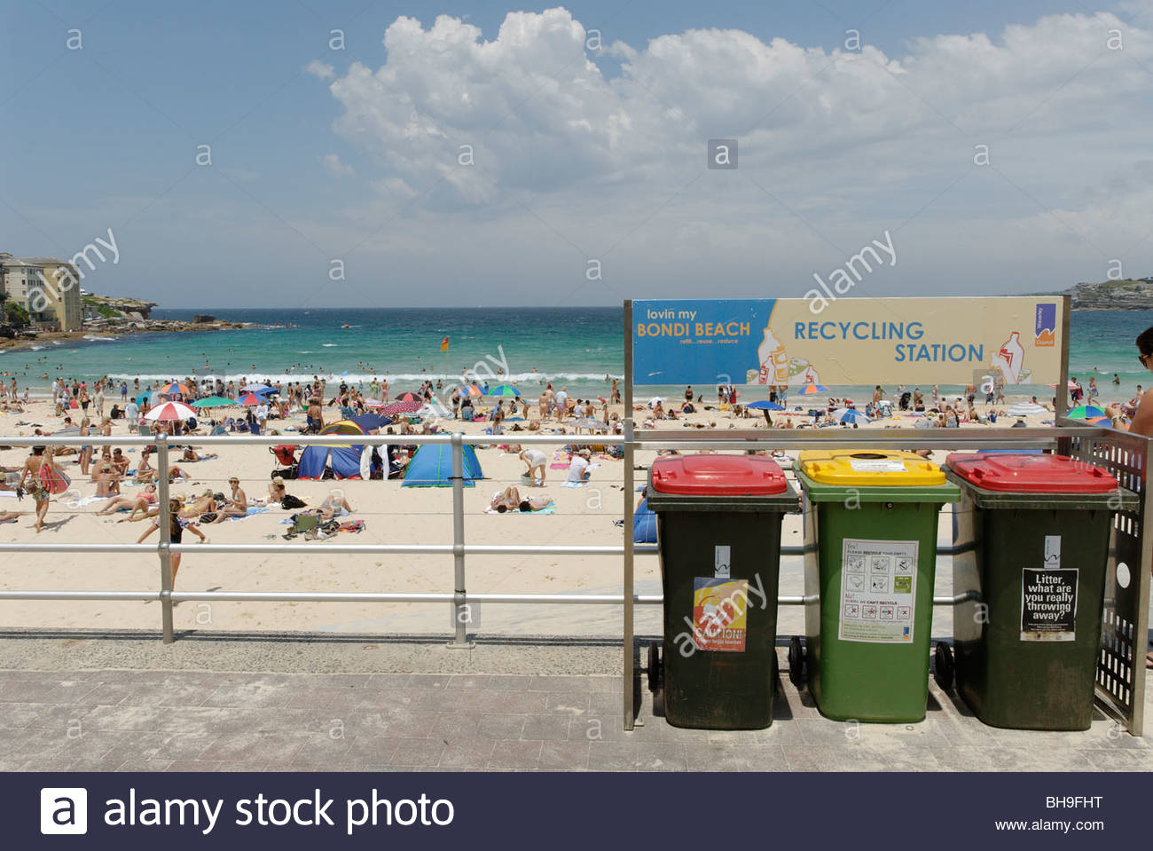separate rubbish bins for recycling on Bondi Beach - Stock Image