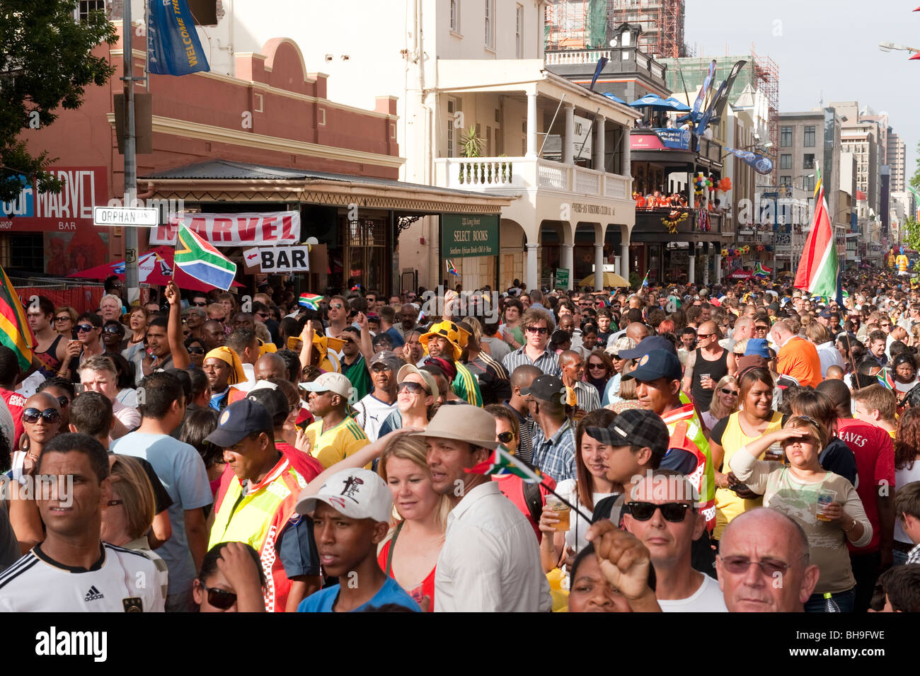 Football fans celebrating on the FIFA Fan Mile in Cape Town South Africa - Stock Image