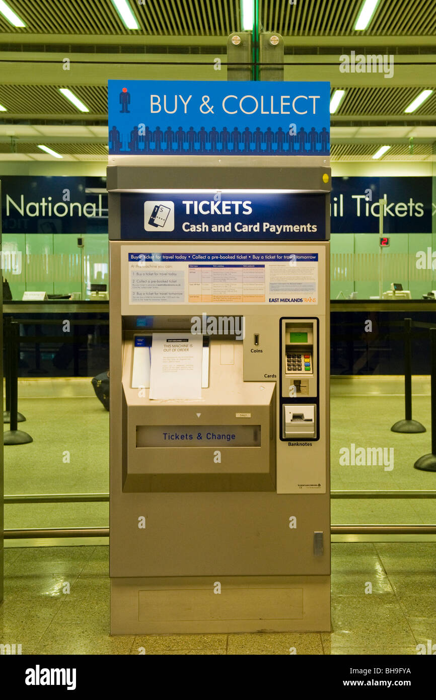 St Pancras Station , automated machine to buy or collect train tickets with payment by cash or card - Stock Image
