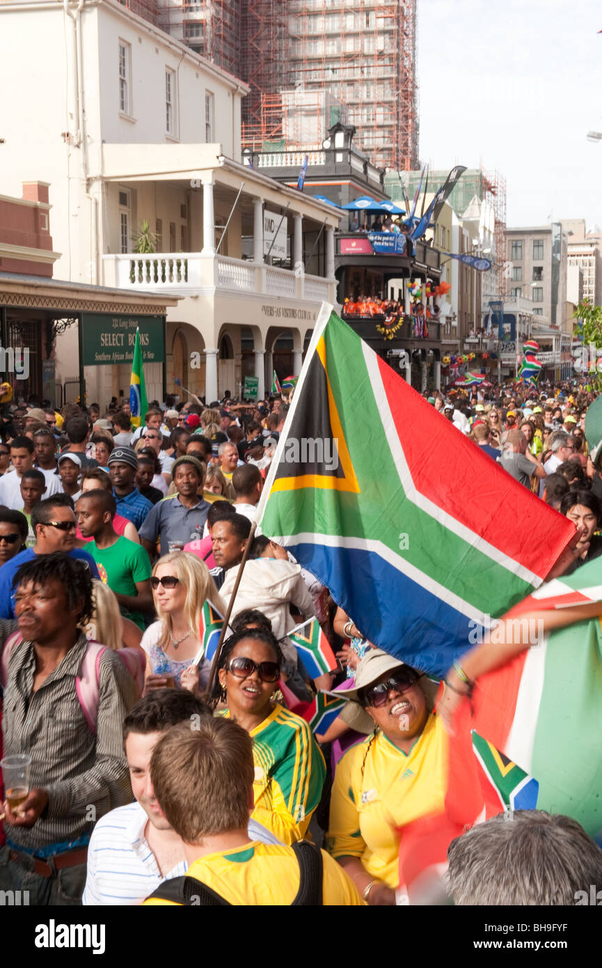 FIFA Fan Fest fans with flag celebrating in Cape Town South Africa - Stock Image