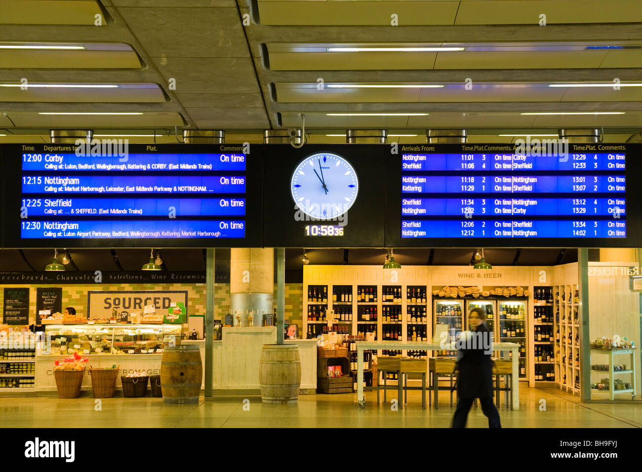 London St Pancras Station departure & arrival times noticeboard or sign with analogue & digital clocks in - Stock Image