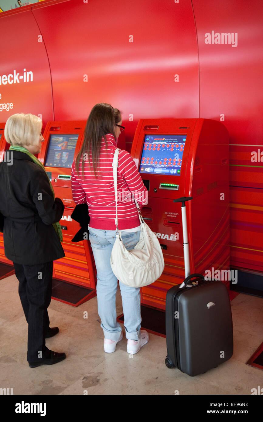 self check in, Iberia, departure level, terminal 4, Madrid Barajas airport, Spain - Stock Image