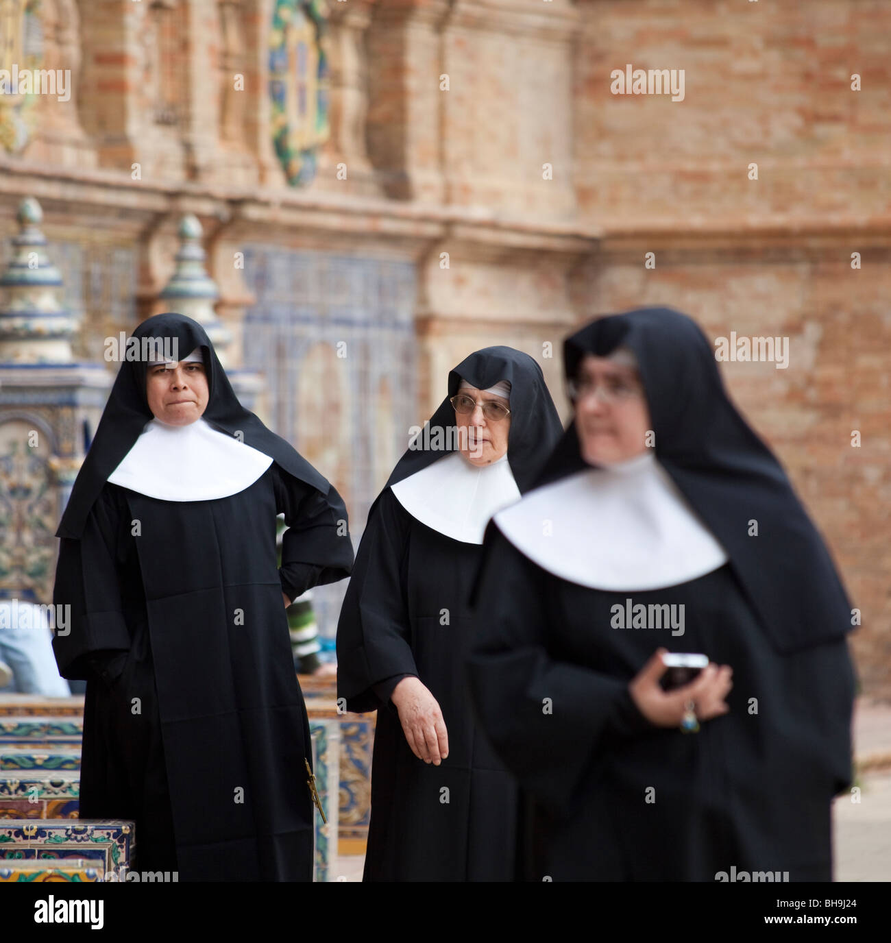 Spanish nuns, visiting Plaza de Espagna, Seville, Spain - Stock Image