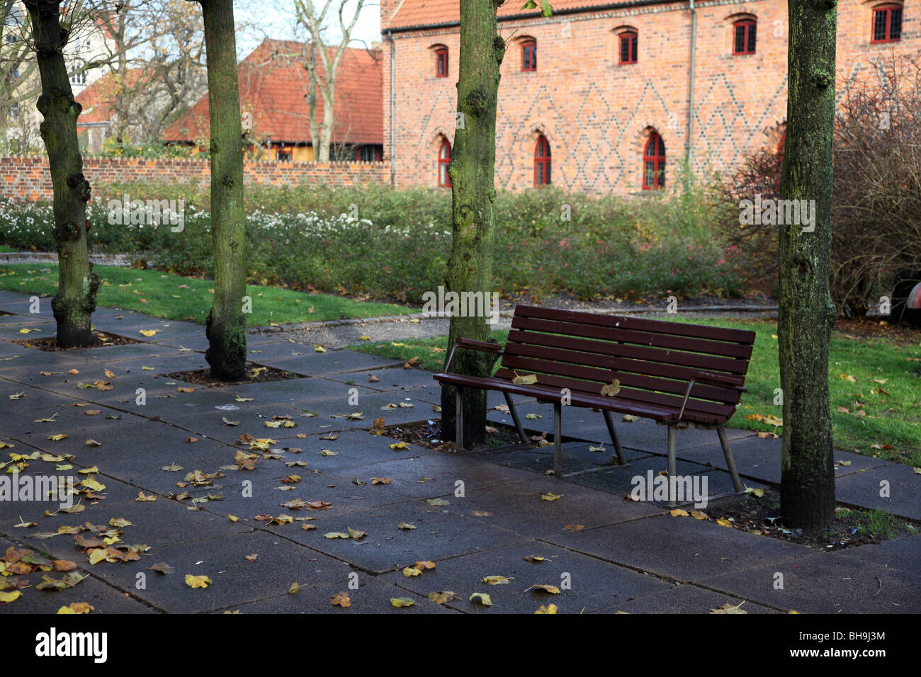 bench in park near cloister - Stock Image