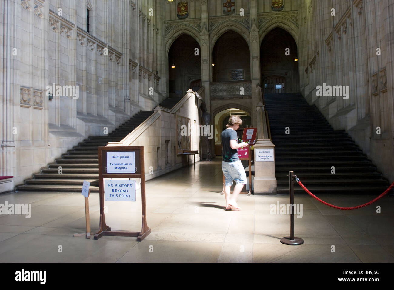 A student by the main stairs of the Wills Memorial Building, University of Bristol, Clifton, Bristol, England, during - Stock Image