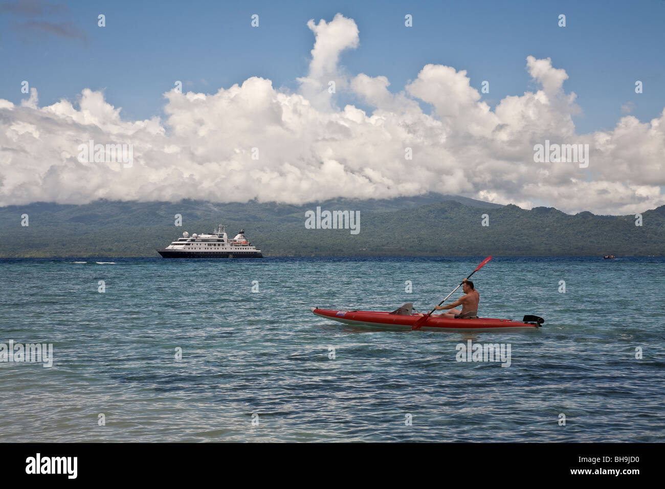 Passengers from the Aussie expedition cruiser Orion have the option of sea kayaking Kennedy Island Solomon Islands - Stock Image