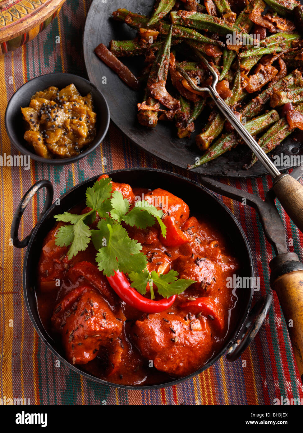 Chicken vindaloo indian hot curry okra and aubergine chutney stock chicken vindaloo indian hot curry okra and aubergine chutney forumfinder Images