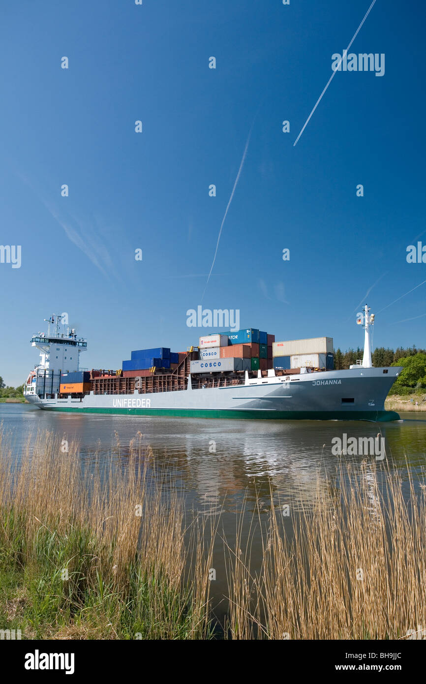 A container feeder-ship at the Kiel Canal. - Stock Image