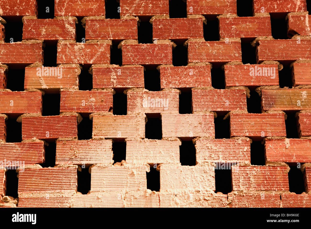 Rough unfinished lattice brickwork. - Stock Image