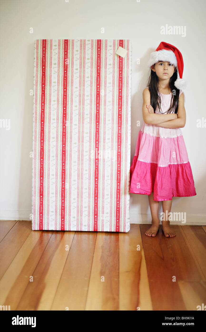 Six year old girl with santa hat - Stock Image