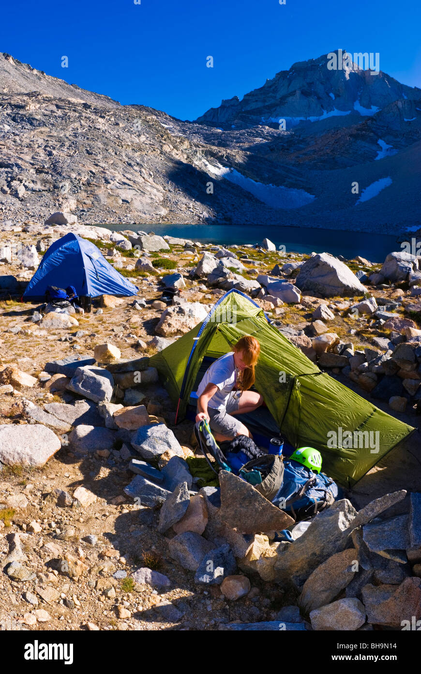 Climber in camp at Dade Lake under Bear Creek Spire, John Muir Wilderness, Sierra Nevada Mountains, California Stock Photo