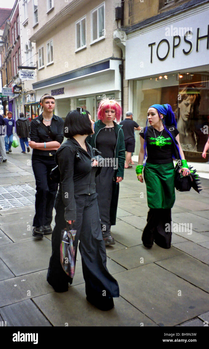 Teenagers in 'punk' attire meet at a new shopping district in the old university town of Cambridge, England. - Stock Image