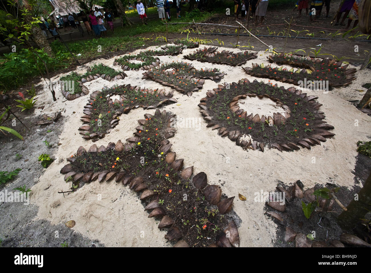 A Melanesian garden spelling the words how are you - Stock Image