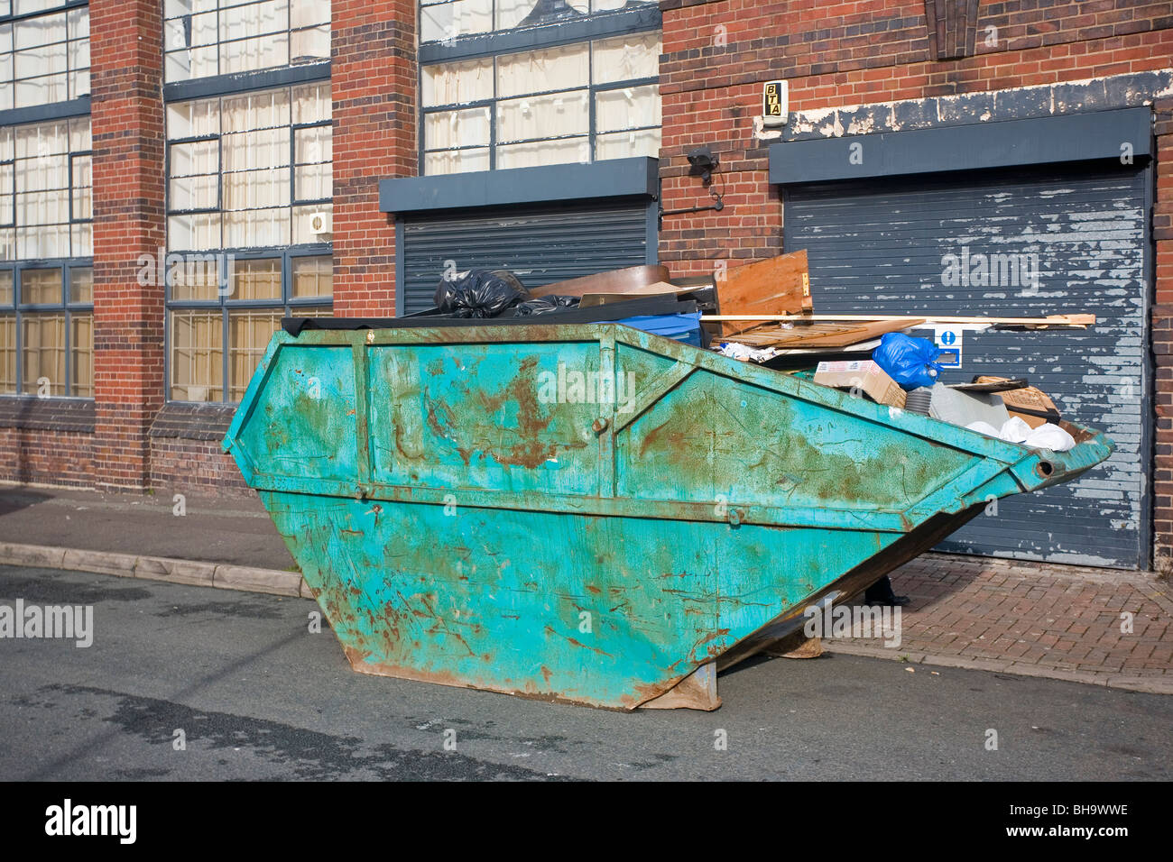 Skip on an industrial estate - Stock Image