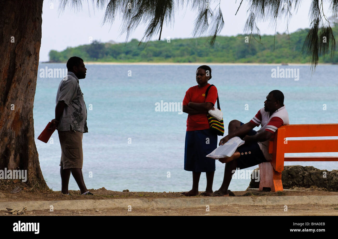 South Pacific Islanders chatting beside the sea - Stock Image