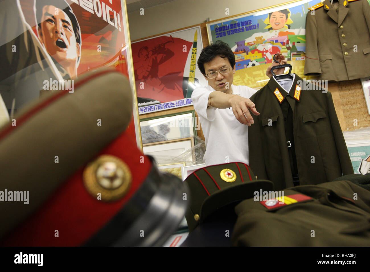 Jun Miyagawa, of Rainbow Trading Company ( a North Korean speciality bookstore) shows off North Korean products for sale. Tokyo. Stock Photo