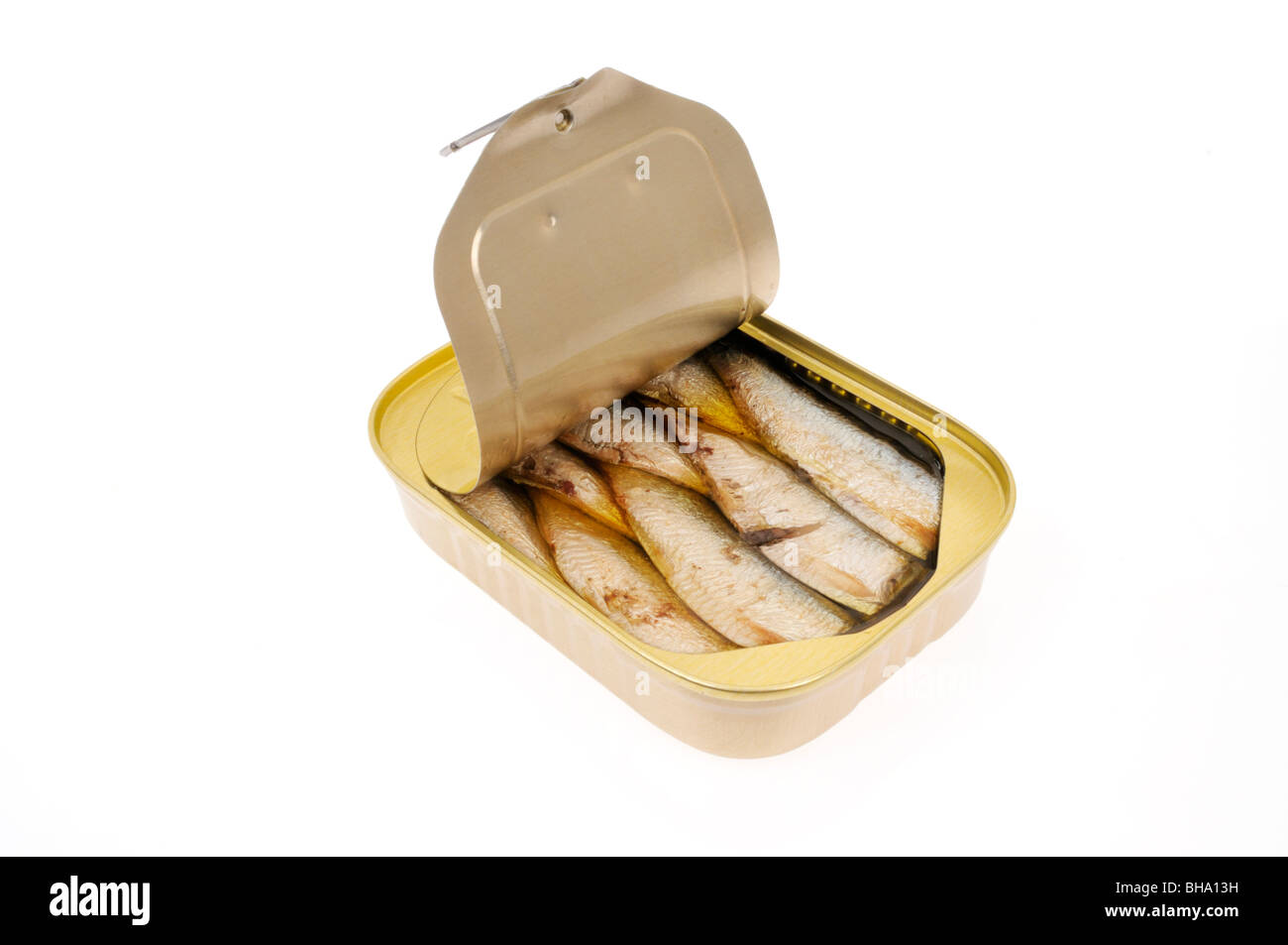 An open pull tab tin of sardines packed in oil on white background, cut out. - Stock Image