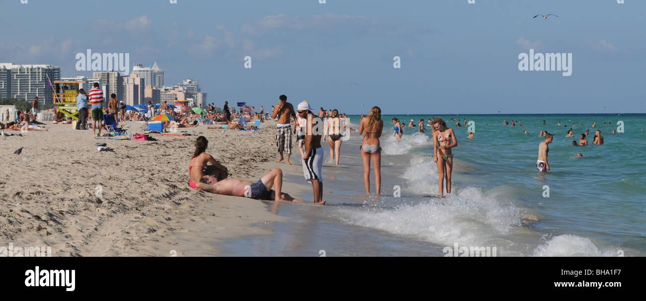 People enjoying the sun sand and warm ocean waters of beautiful South Beach, Miami Beach, Florida. - Stock Image