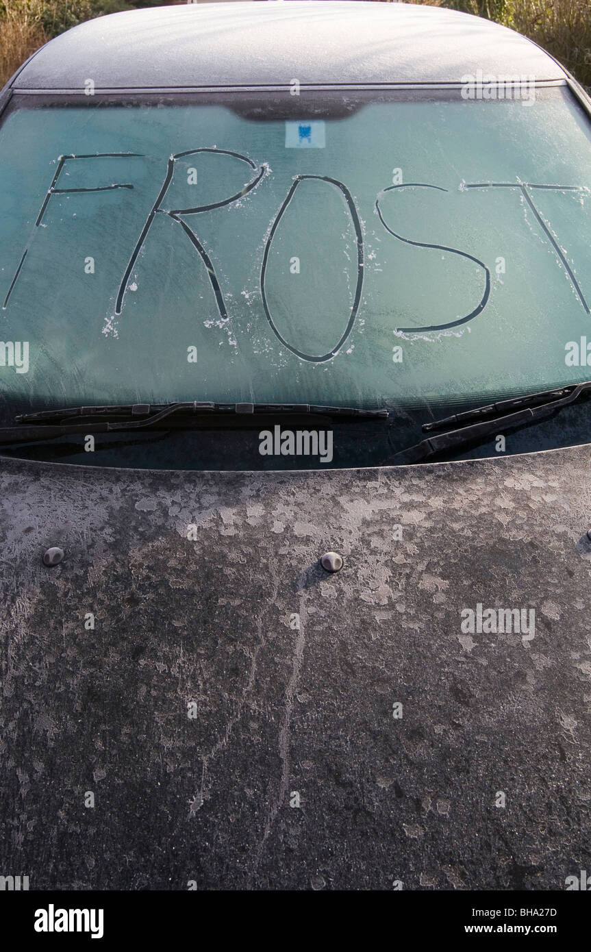 frost frosty morning mornings winter wintery cold freezing freeze big windscreen car cars motoring driving ice icy - Stock Image