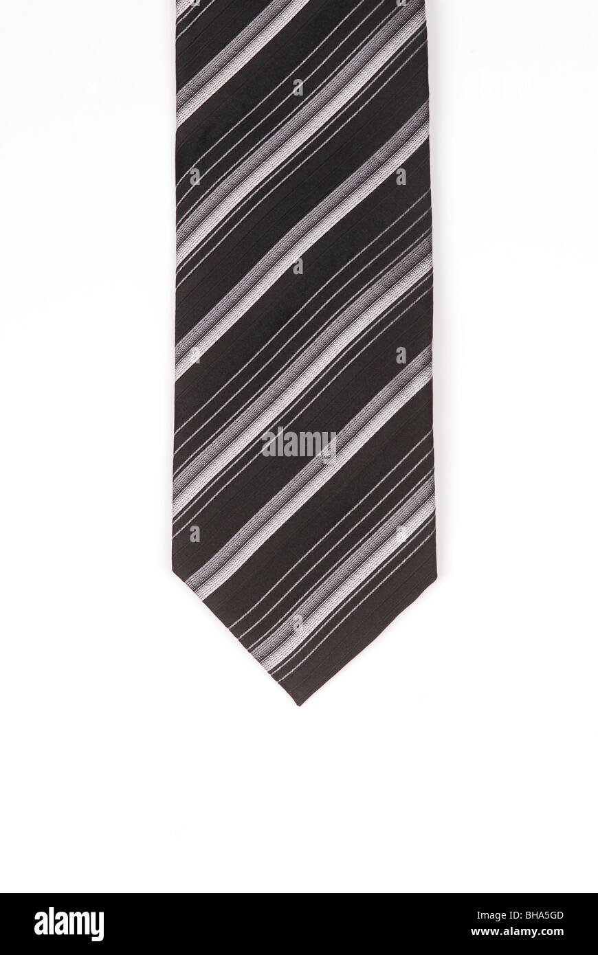 Striped black and white tie on a white backgroundUK - Stock Image