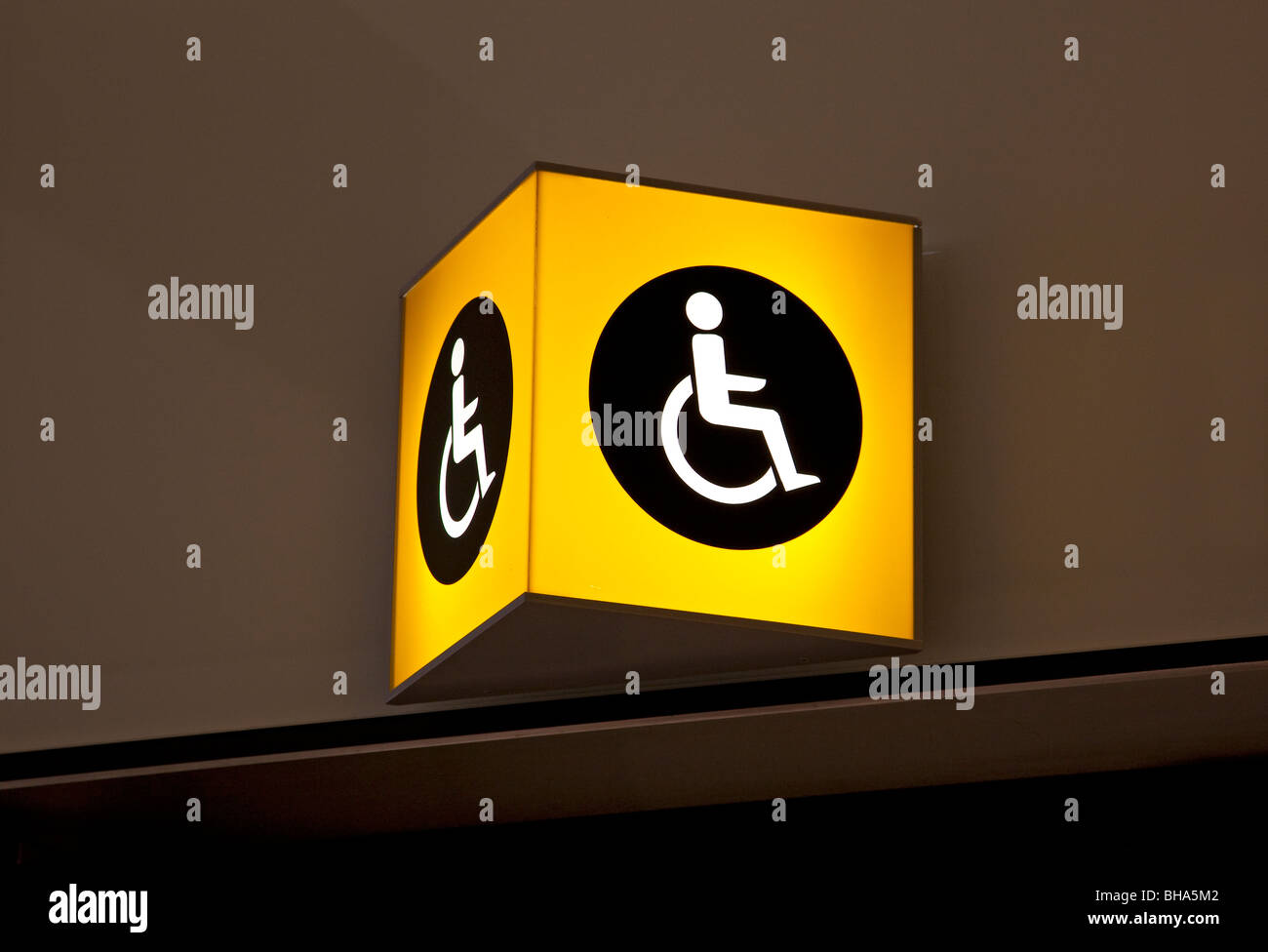 Disabled toilet sign, Terminal 5, Heathrow airport, London, England - Stock Image