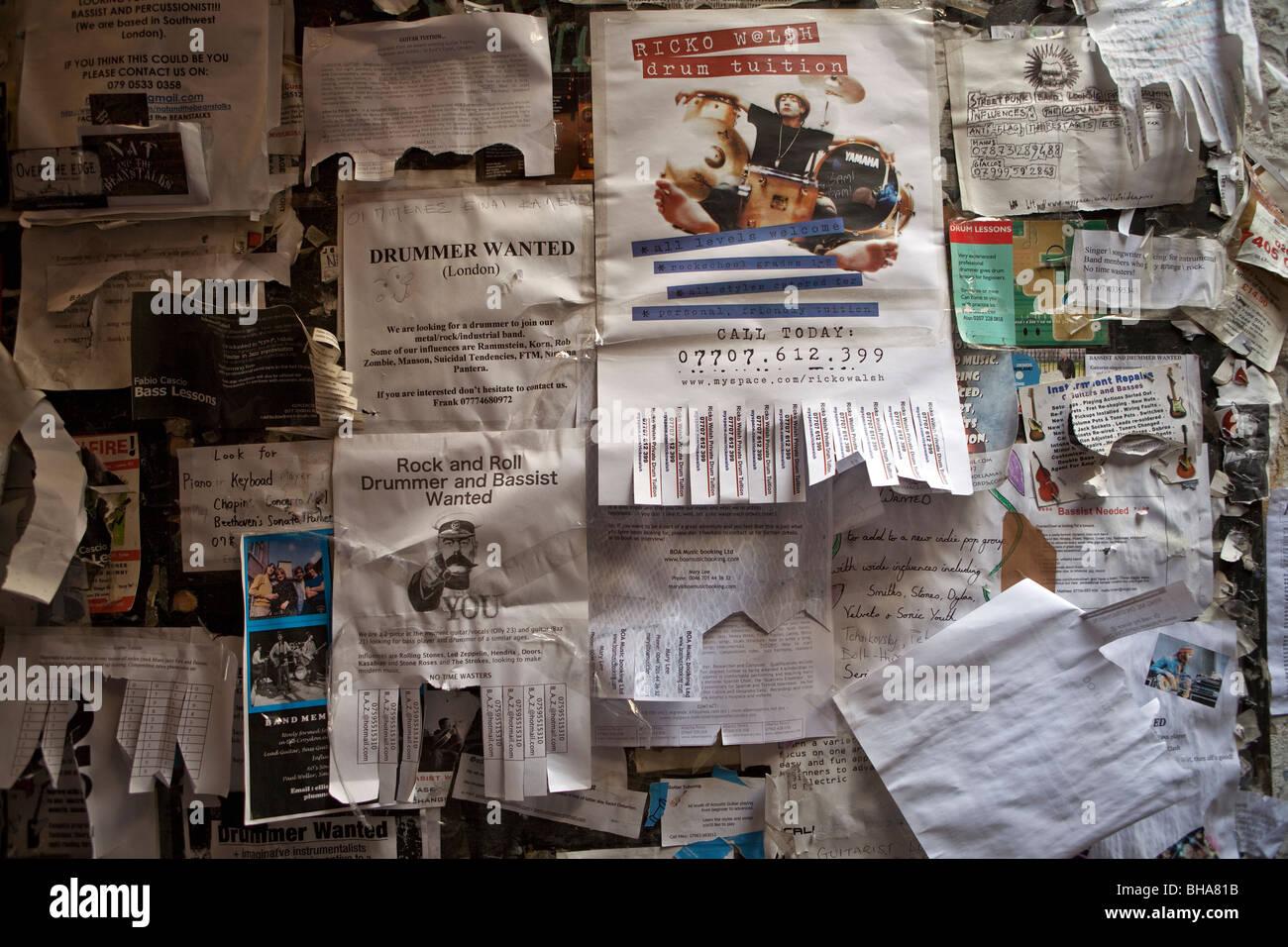 Noticeboard advertising for musicians, Denmark Street, London - Stock Image