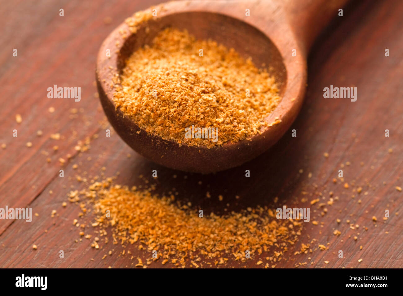 Ground cumin in a measuring spoon - Stock Image