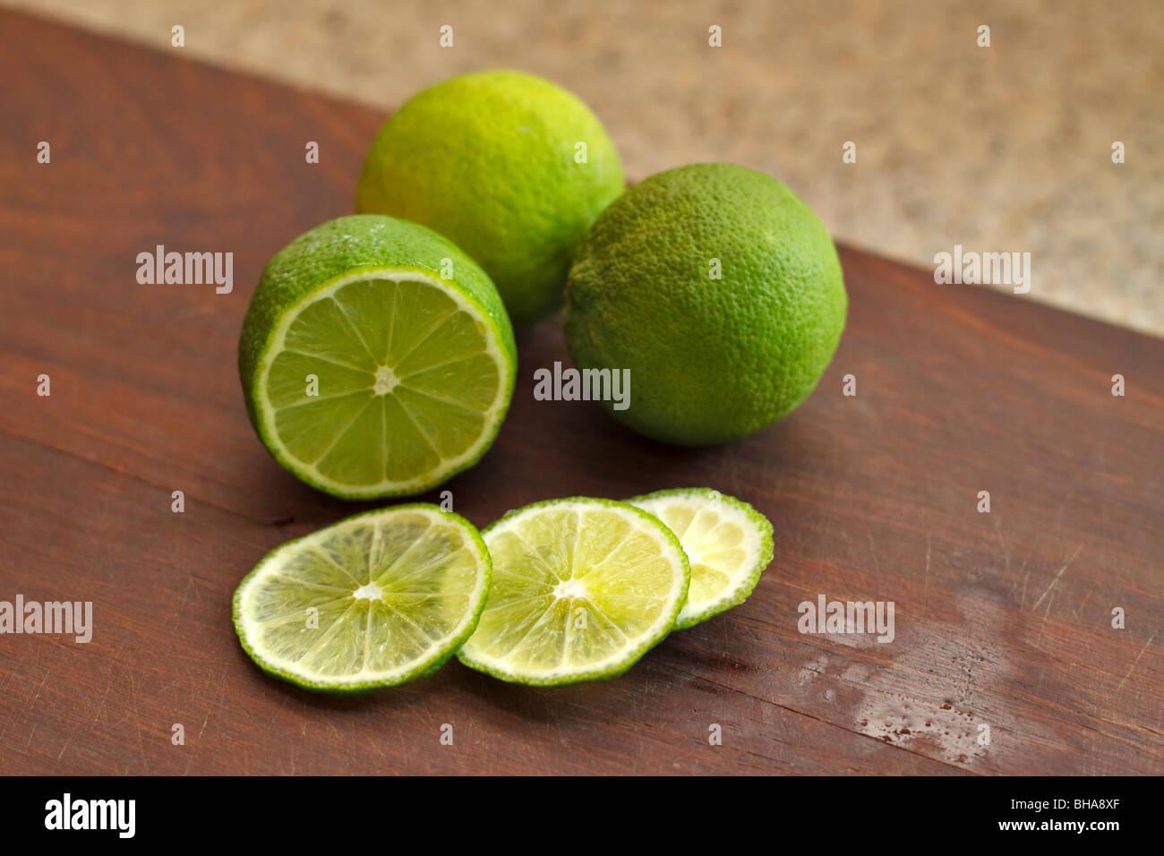 Sliced fresh limes - Stock Image