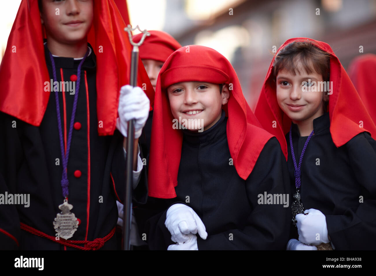 children in the Semana Santa procession in Malaga, Andalucia, Spain - Stock Image