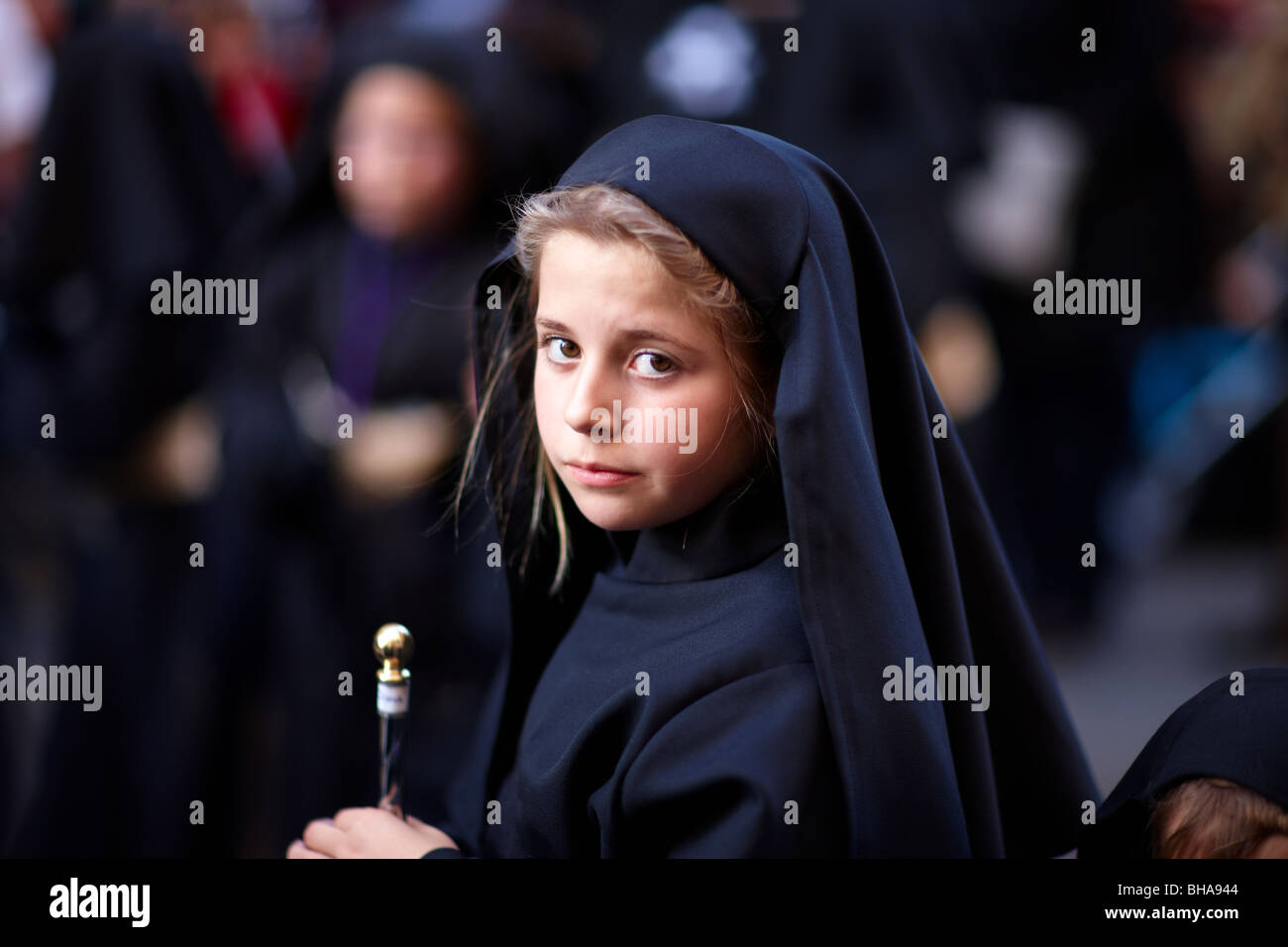a child in the Semana Santa procession in Malaga, Andalucia, Spain - Stock Image