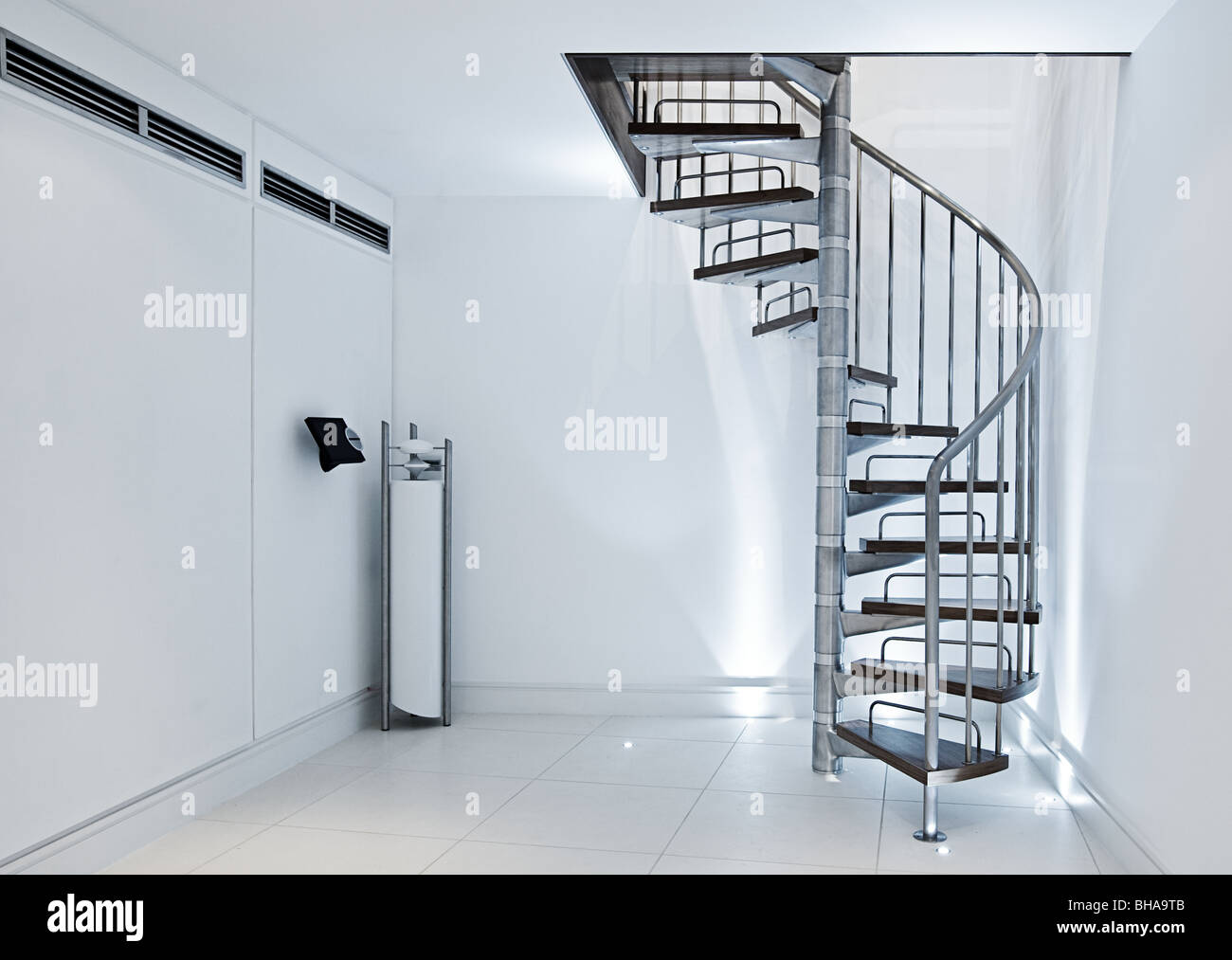 Minimalistic Interior - Spiral Staircase against White Walls - Stock Image