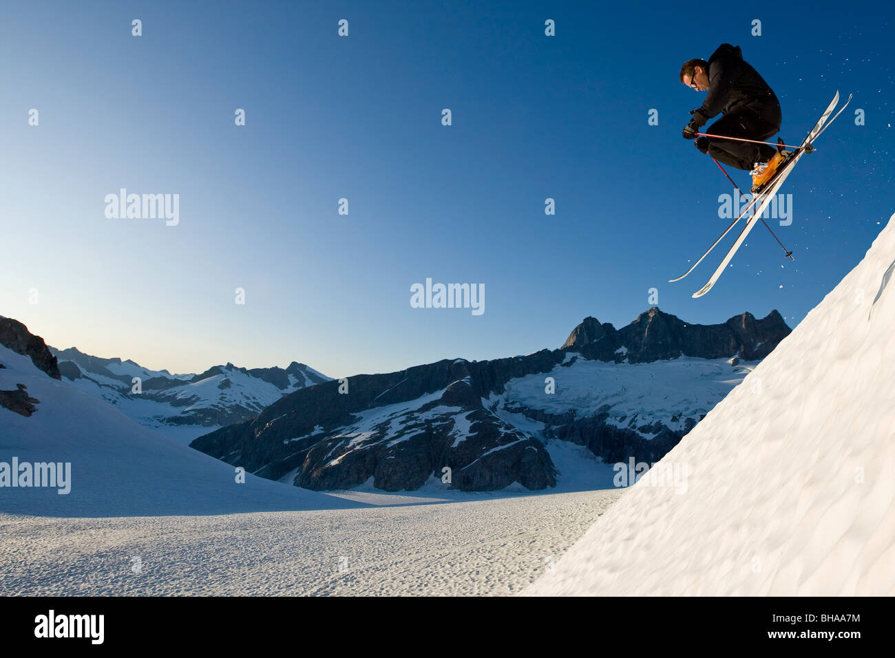 Alpine skier enjoying the wide open and uncrowded skiing in the Juneau area, Mendenhall Glacier, Southeast Alaska Stock Photo