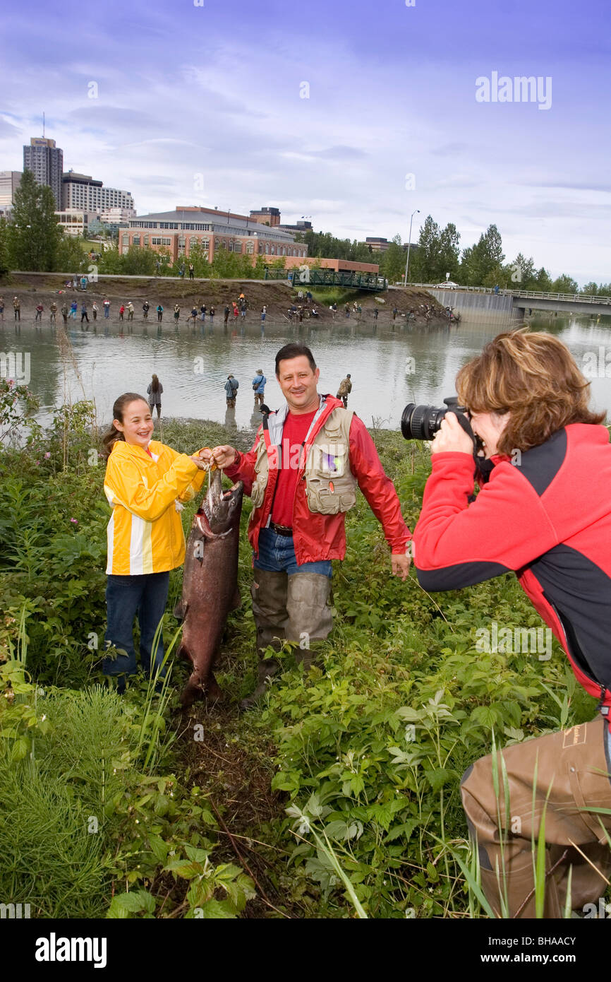 Family Poses for Picture w/Caught King Salmon AK SC/nShip Crk Anchorage Summer Slam'nSalmon Derby Stock Photo