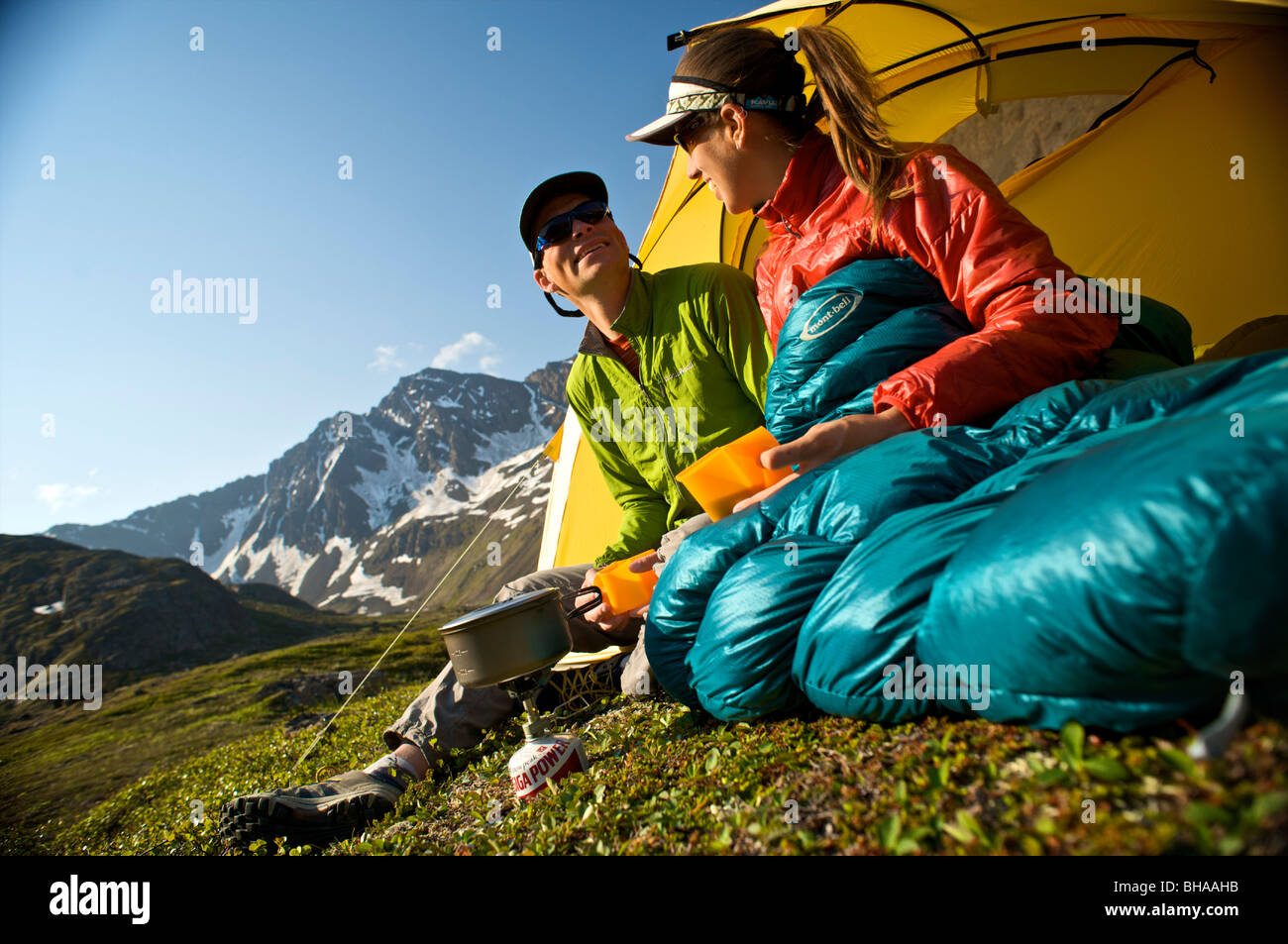 Hikers enjoy a morning meal at camp on the Williwaw Lakes Trail in Chugach State Park near Anchorage,Southcentral - Stock Image