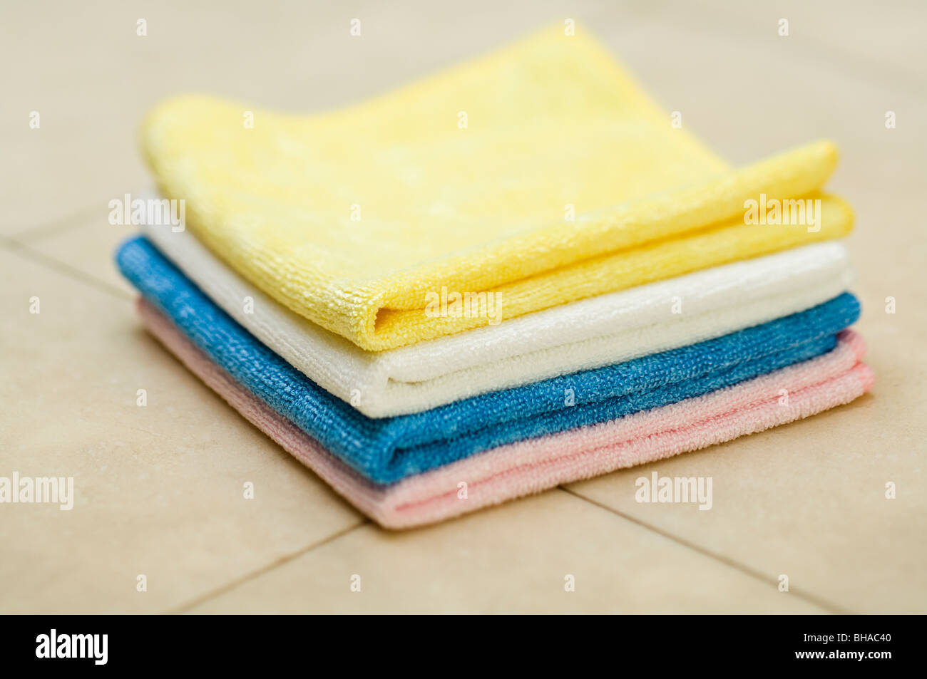 Small pile of cleaning cloths. - Stock Image