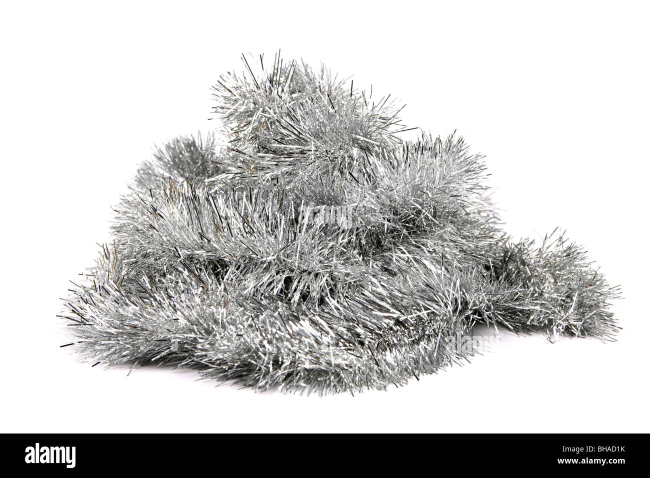 Silver Tinsel against a white background - Stock Image