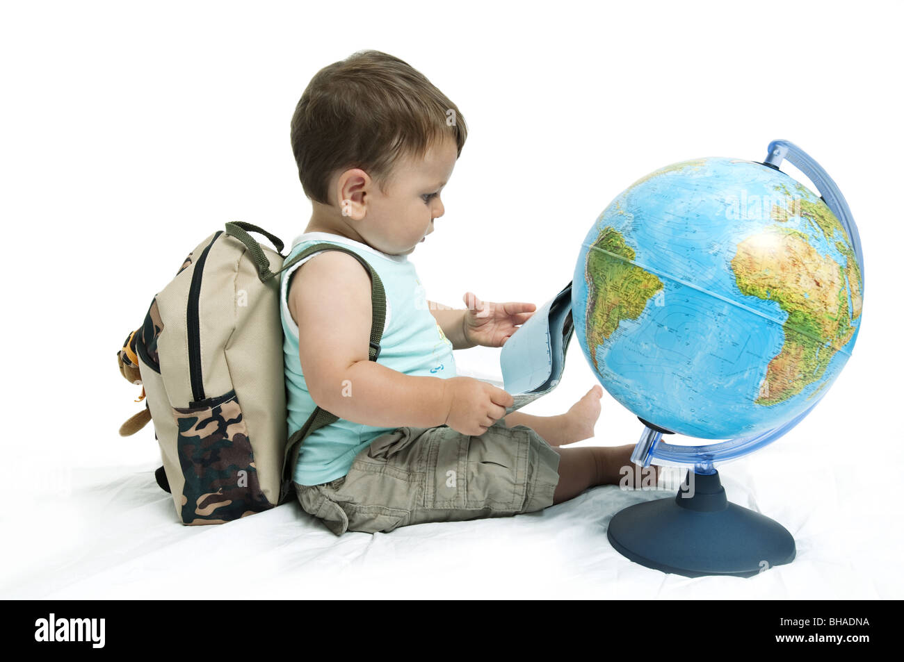 Baby boy with backpack and globe - Stock Image