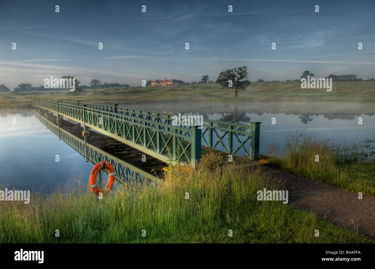 A bridge over the lake at The Oxfordshire Golf Club, Thame, Oxfordshire - Stock Image