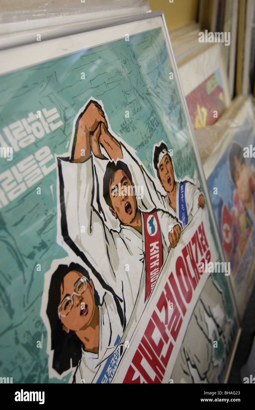 Rainbow Trading Company ( a North Korean speciality bookstore) shows the North Korean posters they have for sale. - Stock Image