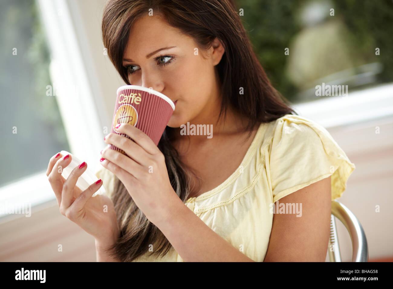 Girl drinking coffee - Stock Image