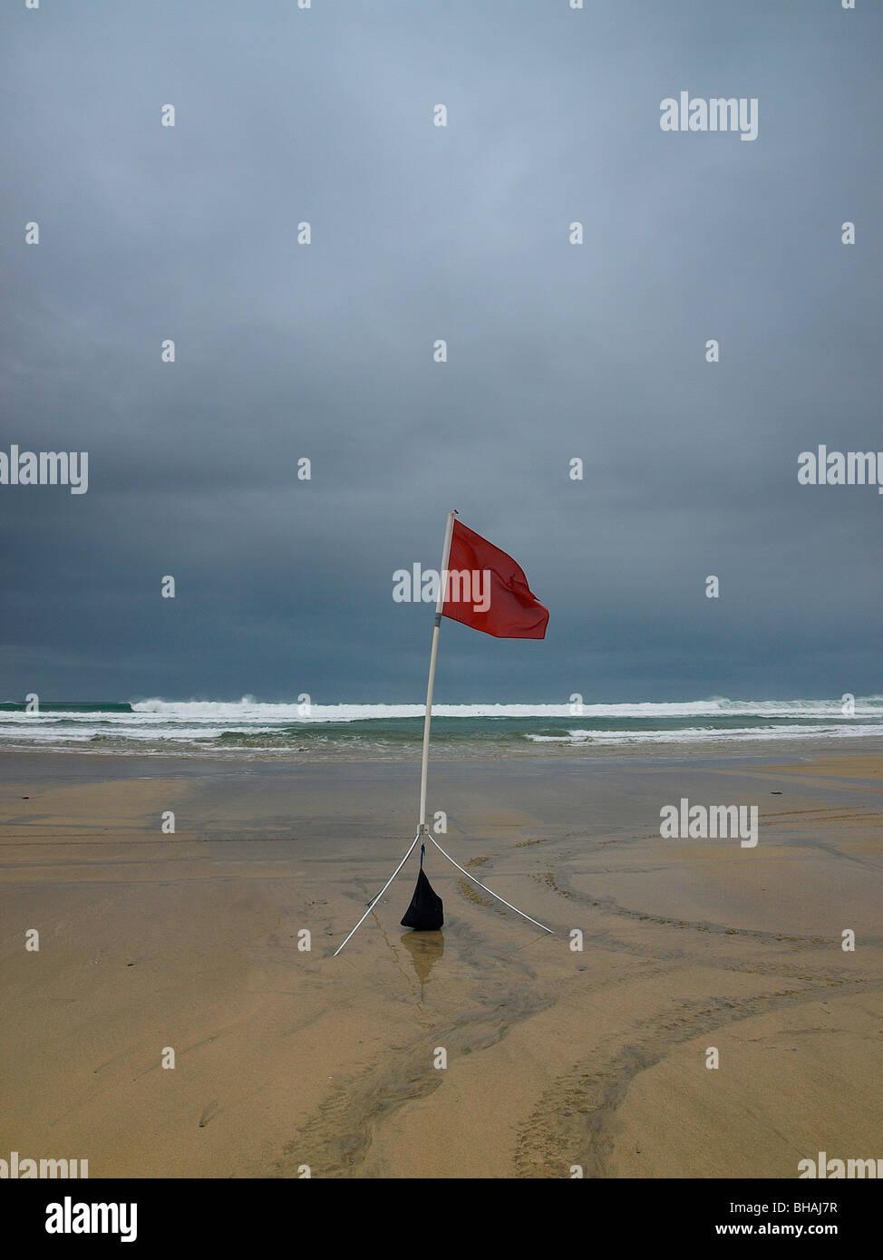 Unsafe bathing flag, Gwithian Towans, Cornwall, UK - Stock Image