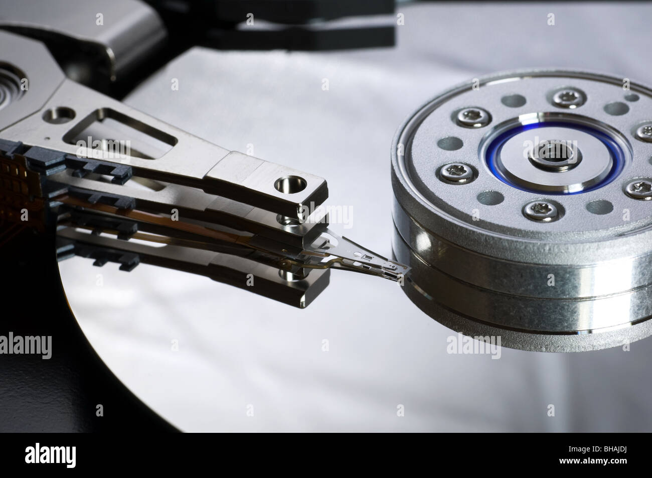 Dismantled hard drive showing platter and read/write head - Stock Image